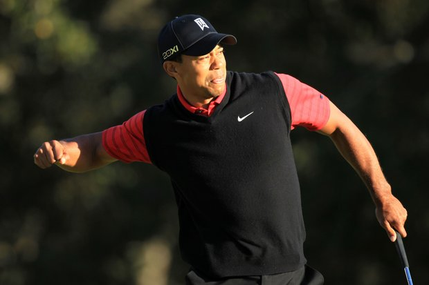 Tiger Woods celebrates after his birdie putt on the 18th hole to win the Chevron World Challenge .