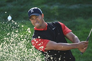 Tiger Woods plays a bunker shot on the 12th hole during the final round of the Chevron World Challenge.