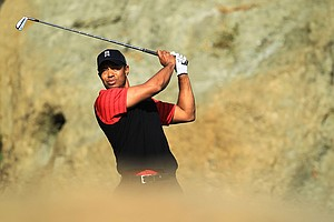 Tiger Woods watches his tee shot on the eighth hole during the final round of the Chevron World Challenge.