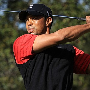 Tiger Woods hits his tee shot on the sixth hole during the final round of the Chevron World Challenge.