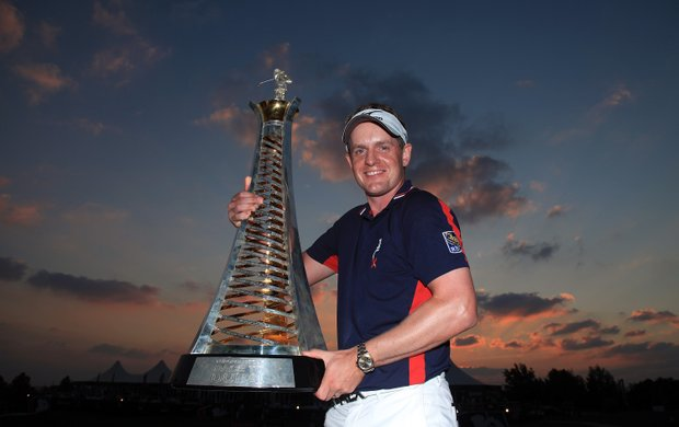 Luke Donald holds the Race to Dubai Trophy after finishing in third place that secured his title during the final round of the Dubai World Championship.