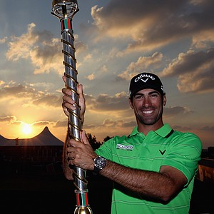 Alvaro Quiros of Spain poses with the trophy after winning the Dubai World Championship.