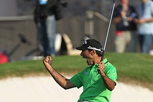 Alvaro Quiros reacts after winning the Dubai World Championship in style when he rolled in a long eagle putt on the 18th green.
