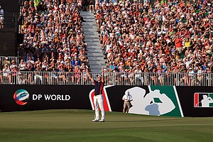 Luke Donald holes a birdie putt at the par 5, 18th hole to finish in third place that secured his Race to Dubai title during the final round of the Dubai World Championship.