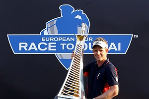 Luke Donald poses with the trophy after winning The Race To Dubai at the Dubai World Championship.
