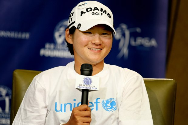 Yani Tseng in the interview room, sports a T-shirt in honor of her chosen charity, UNICEF during the RR Donnelley LPGA Founders Cup.