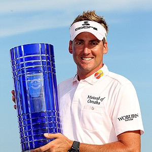Ian Poulter holds the trophy after winning the Volvo World Match Play Championship.