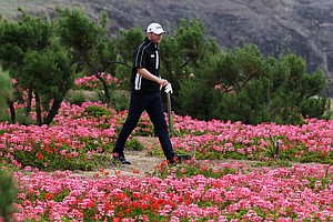 Champion Michael Hoey walks to the 18th hole during the final round of the Madeira Islands Open.