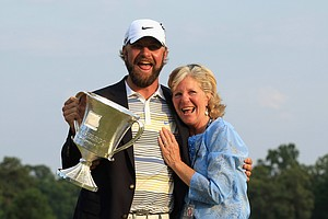 Lucas Glover and his mother Hershey Glover after the final round of the Wells Fargo Championship at Quail Hollow Club, where Glover defeated former Clemson teammate Jonathan Byrd in a playoff.