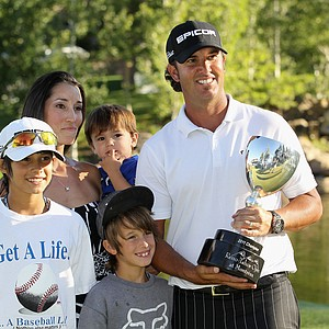 Scott Piercy poses with his family after he won the Reno-Tahoe Open at Montreux Golf & Country Club.