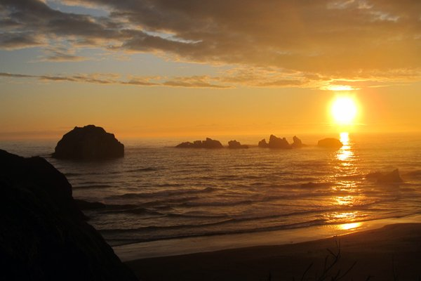 With Face Rock on the left, a spectacular view of Bandon at sunset.