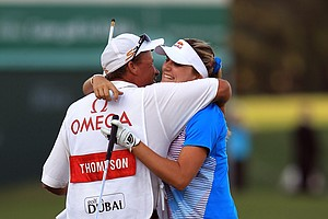 Lexi Thompson celebrates with her father Scott Thompson after she had birdied the par 5, 18th hole to secure her four-shot victory during the fourth round of the 2011 Omega Dubai Ladies Masters.