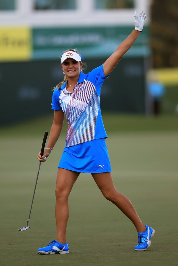 Lexi Thompson celebrates after birdieing the par 5, 18th hole to secure her four shot victory during the fourth round of the 2011 Omega Dubai Ladies Masters.