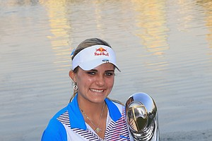 Lexi Thompson proudly holds the trophy after her four shot victory during the fourth round of the 2011 Omega Dubai Ladies Masters.