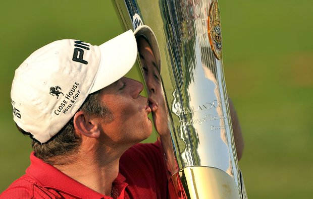 Lee Westwood kissing the winner's trophy after the final round at the Thailand Golf Champioship.