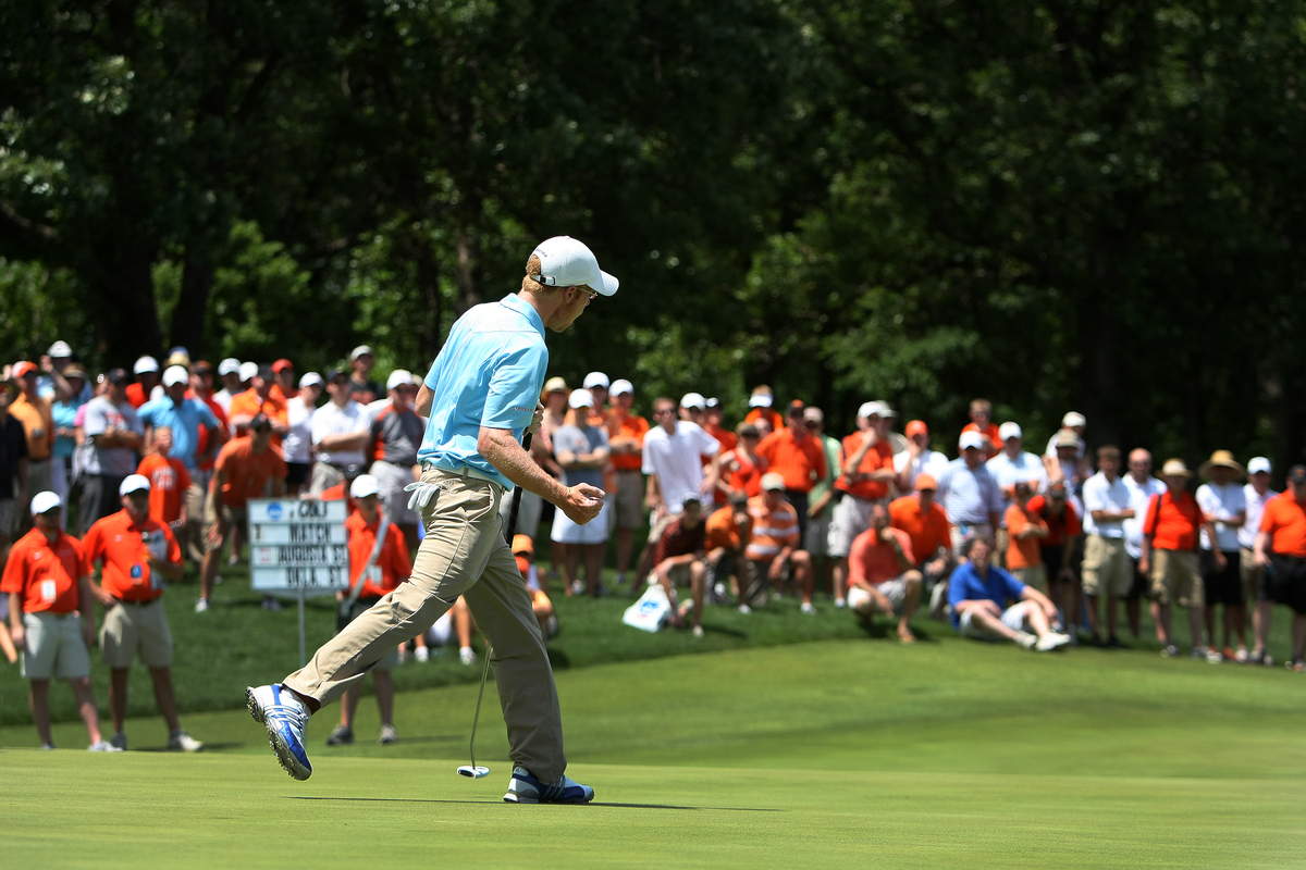 "Augusta State's Carter Newman drops a putt during the semifinals of the NCAA Championship in front of a ""sea of orange."""