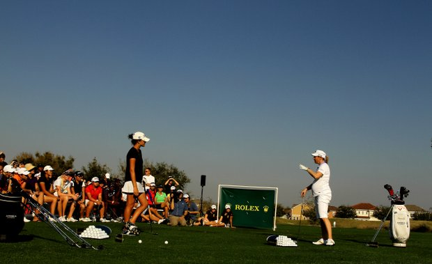 Jaye Marie Green hits balls with Annika Sorenstam, who is 5 months pregnant, during The Annika Clinic at the Annika Academy at Reunion Resort. Sorenstam was pregnant with her second child.