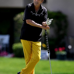 American rocker, Alice Cooper, is an avid golfer, He waits at No. 16 green during his pro-am with LPGA's Sun Young Yoo at the Kraft Nabisco Championship.