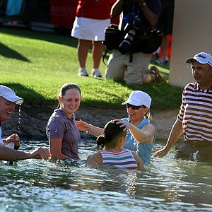 Stacy Lewis and her family after jumping into Poppie's Pond after she won her first major. Lewis' mom injured her leg during the jump. Jumping into the pond has become a tradition at the Kraft Nabisco.