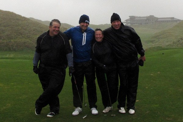In Ireland in early October, Dave Cannon (from right), Dove Jones, Robbie Greenfield and the author may be cold and soaked, but they're determined to finish 18 holes.