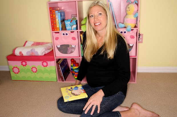 Former Duke golfer Beth Bauer posing in her nursery. Bauer is expecting her first child near Christmas Day.