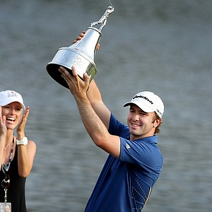 Martin Laird wins the Arnold Palmer Invitational at Bay Hill Club & Lodge. At left is Arnold Palmer and Laird's fiance.