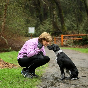 Cindy Davis, Nike Golf president and her puppy Tilly, a rescue get ready for a jog near Portland, Oregon. Davis was photographed for the Golfweek for Her 2011 edition.