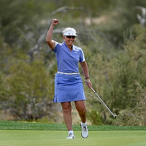 LPGA Hall of Fame member, Patty Sheehan, reacts to sinking a long putt at No. 16 during an exhibition 18 holes in Round 1 of the RR Donnelley LPGA Founders Cup. Sheehan won 35 LPGA tournaments in her career.