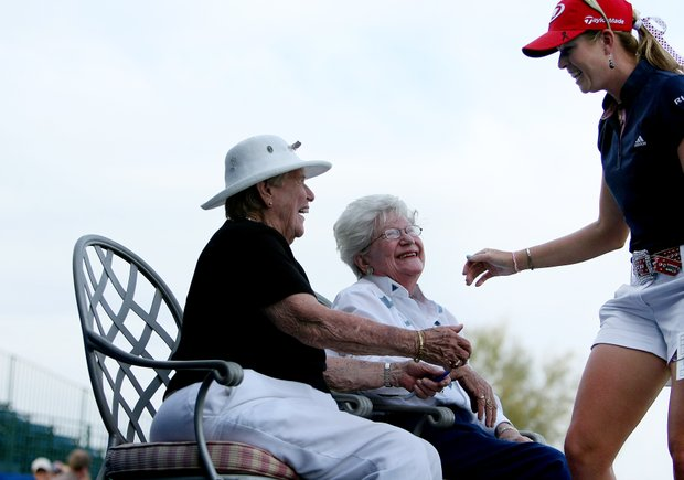 Paula Creamer greets a couple of the original LPGA founders, Shirley Spork and Marilynn Smith, at No. 18 during Round 1 of the RR Donnelley LPGA Founders Cup. Smith had 23 wins in her career.