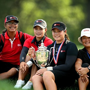 Ariya Jutanugarn, center with trophy, poses with her family, from left, father, Somboon, sister, Moriya and far right her mother, Narumon, after winning the 63rd U. S.  Girls' Junior Championship at Olympia Fields Country Club. The Jutanugarn sisters had an amazing 2011.
