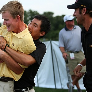 LSU's Sang Yi picks up John Peterson, the NCAA Individual winner, afterThursday stroke play at the 2011 NCAA Division I Men's Golf Championship at Karsten Creek in Stillwater, Oklahoma.