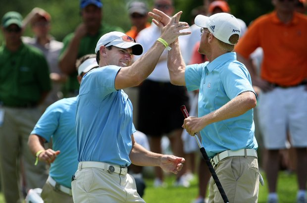 Augusta State's Carter Newman clinches the final point to beat Oklahoma State during Semifinals of Saturday's Match Play at the 2011 NCAA Division I Men's Golf Championship at Karsten Creek in Stillwater, Oklahoma. He celebrates with acting assistant coach, Kevin McPherson. McPherson is now the head coach at Augusta State.