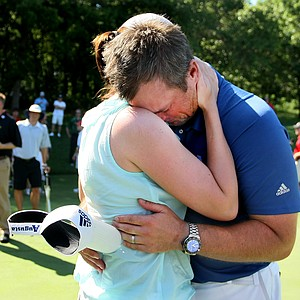 Augusta State head coach Josh Gregory embraces his wife Ashley after the Jaguars defended thier national title at the 2011 NCAA Division I Men's Golf Championship at Karsten Creek in Stillwater, Oklahoma. Gregory has since left and is now the head coach at Southern Methodist University.