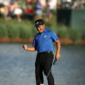 K. J. Choi celebrates at No. 17 with a birdie putting him in the lead heading into No. 18 on Sunday during the final round at the The Players Championship. He defeatd David Toms at the same hole in a playoff.