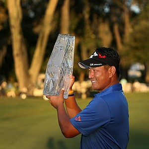 K. J. Choi with the trophy at No. 18 on Sunday at The Players Championship. Choi defeated David Toms in a playoff.