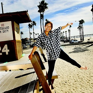 Ai Miyazato having fun on a lifeguard stand while being photographed in Newport Beach, California, for the 2011 Golfweek for Her edition.