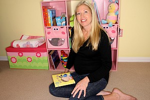 Beth Bauer who is expecting her first child in late 2011, poses in the baby's room recently.