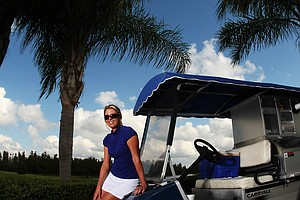 Color version of previous photo: Former Duke golfer, Beth Bauer, held a job as the beverage cart driver at Heritage Harbor Golf and Country Club in Lutz, Fla. In the LPGA, Bauer earned top-rookie honors with six top-10s, finishing 18th on the money list.