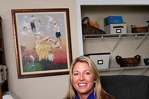 Former Duke golfer, Beth Bauer, poses in her office where she lives outside Tampa.
