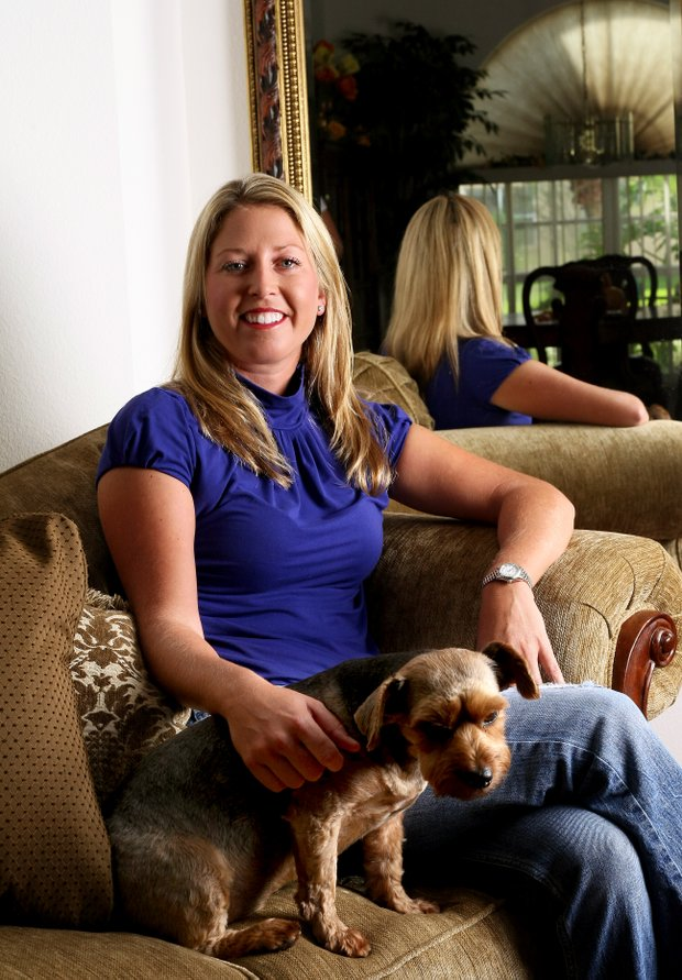 Beth Bauer photographed here in 2009 poses with her dog at her home outside Tampa. She is expecting her first child in late 2011.