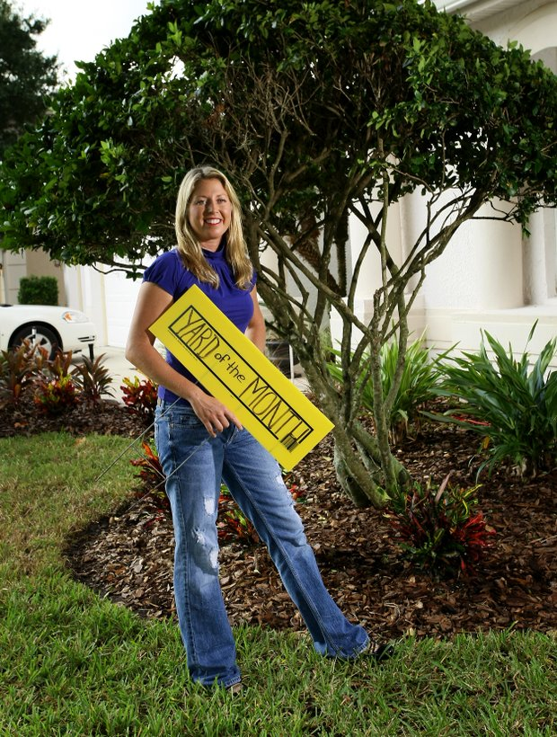 "Beth Bauer photographed in 2009 outside her home had just taken ""Yard of the Month"" honors."