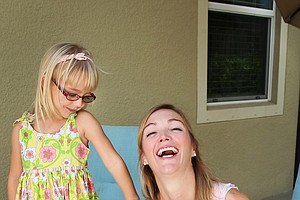 Catherine Tumbleson, formerly Cartwright shares a laugh with her daughter Maci during a recent Golfweek photo shoot at her home in Bonita Springs, Fla., daughter Ella is at right.