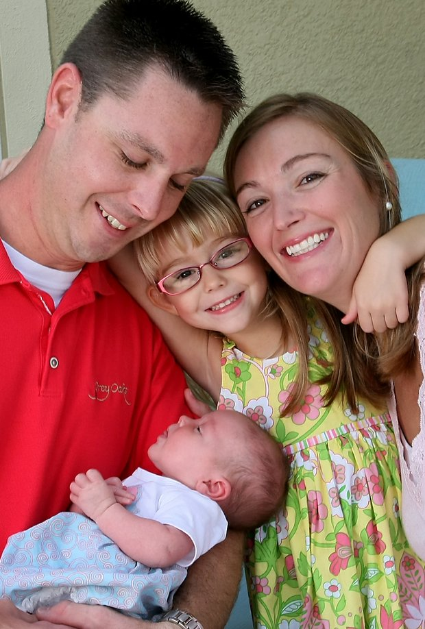 Catherine Cartwright Tumbleson, far right, with her family, Jerrod, left, Maci, center and Ella, bottom. Cartwright left golf after the 2006 LPGA season.