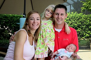 The Tumbleson family all smiles at their home in Bonita Springs. Catherine, left, her husband Jerrod, right with baby Ella and Maci in the center. She is now a school teacher.