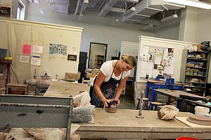 May Wood-Frederiksen photographed at a pottery studio at Vanderbilt University. In 2007 May Wood-Frederiksen went back to Vanderbilt University to complete her degree.