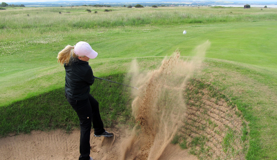 Jenny Kellams blasts out of a bunker at Gullane No. 1.