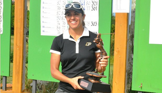 Paula Reto holds the Dixie Women's Amateur trophy after winning the event for the second consecutive year.