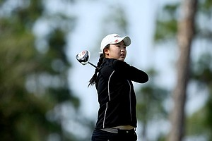 Simin Feng of Orlando, FL, hits her tee shot at No. 2.