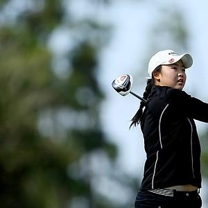 Simin Feng of Orlando, FL, hits her tee shot at No. 2.