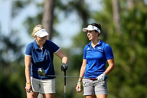 Portland Rosen, left, who plays for the University of Virginia and Kyle Roig, right, who plays for UCLA chat during the 57th Harder Hall Women's Invitational.